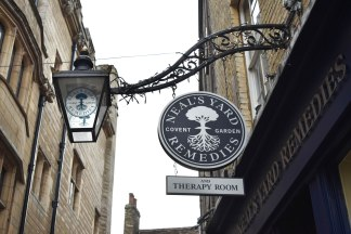 A photograph of the shop sign and old fashioned lamp outside the shop