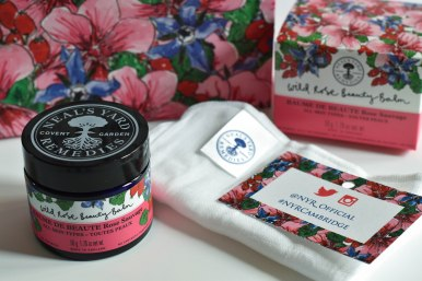 A photograph of Emma's complimentary pot of Wild Rose Beauty Balm with muslin