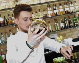 A photograph of Daniel, the mixologist at Poets House