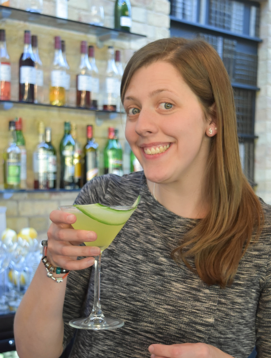 A photograph of Emma's friend holding her finished Cucumber Martini