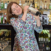 A photograph of Emma shaking her first cocktail