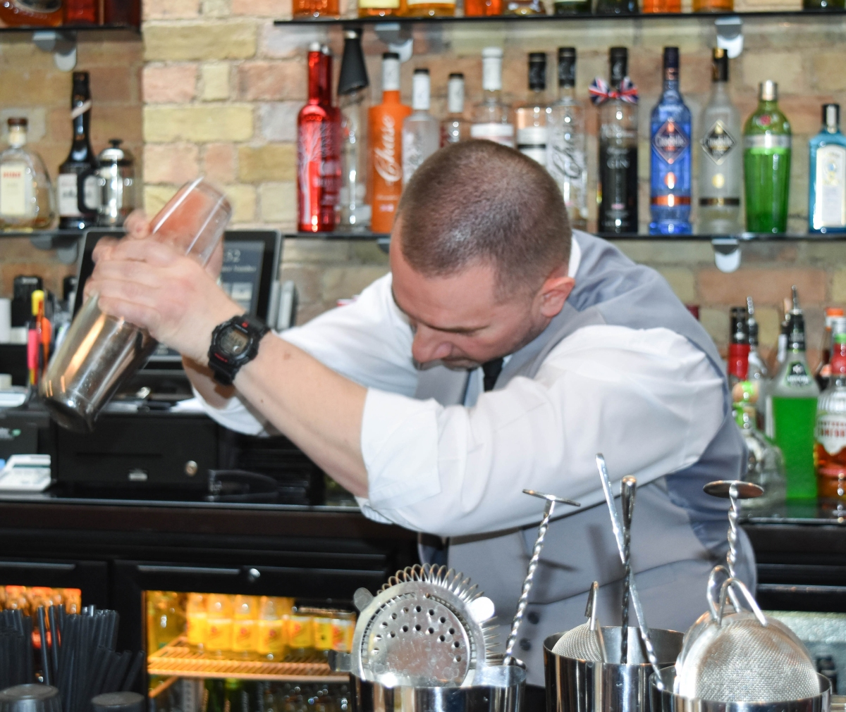 A photograph of Vio, the Poets House Bar Manager