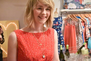 A close-up photograph of Laima wearing an Abigail dress with star print.