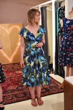A photograph of Laima wearing the Ada dress with Poppies a Plenty print
