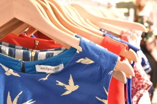 A close up photograph of Emily and Fin high summer dresses on a clothes rail