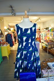 A photograph of a mannequin dressed with an Isobel style dress in British Cruising Boats print