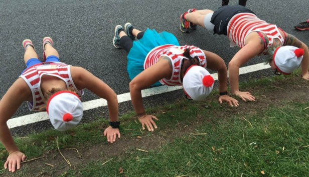 A photograph of three wallys doing the 22 Push Up Challenge