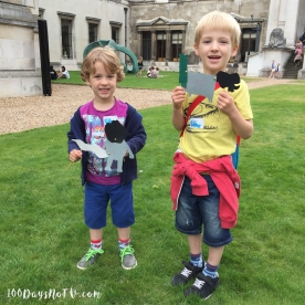 A photograph of both boys standing outside the Fitzwilliam Museum holding up their puppets