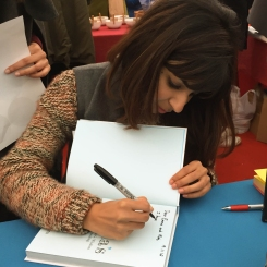A photograph of Anneeka signing the book for Emma and Rob