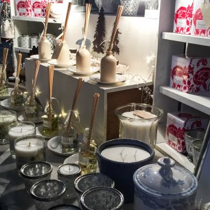 A photograph of one gift stall selling candles and scented reed diffusers and other pretty things