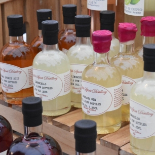 A photograph of several small bottles of fruit flavoured vodkas from the English Distillery