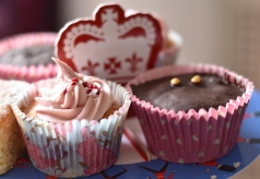 A photograph of a Raspberry and Coconut Cupcake with pink piped icing on top