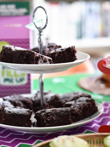 A photograph of some Vegan Chocolate Brownies on a two-tier cake stand