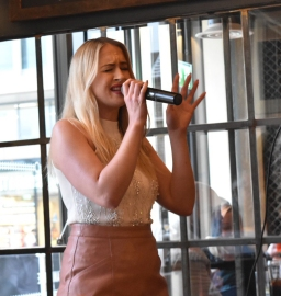 A photograph of Leanne Jarvis in full singing pose.