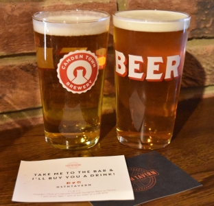 A photograph of two pints: Camden Pale Ale and Camden Hells. In front of these lay two drinks tokens given to Emma and Rob