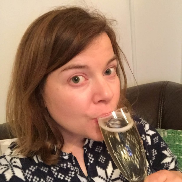 A photograph of Emma once her friends had gone home. She's in her PJs with a celebratory glass of Prosecco