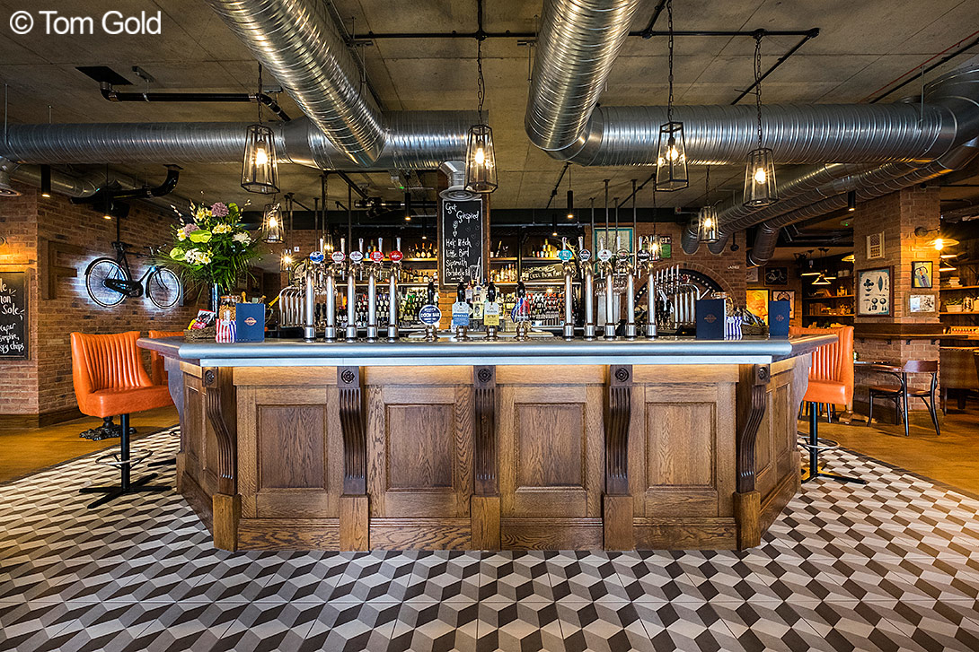 A photograph of the large bar which serves every kind of drink you can imagine! Photo taken by Tom Gold.