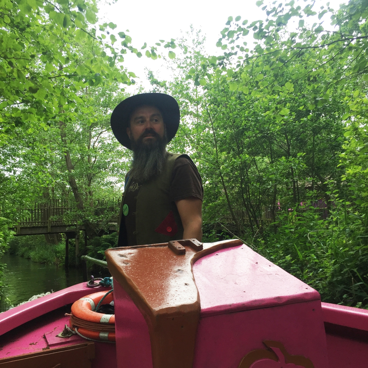 A photograph of Chris the boatman on his pink boat.