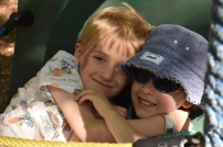 A photograph of Ollie and Ben enjoying a cuddle.