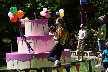 A photograph of a giant pink wooden cake which held a Mildred-shaped surprise.