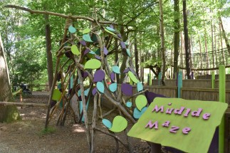 A photograph of the entrance to the Mudlde Maze. The spelling mistake is deliberate!