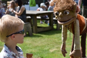 A photograph of Ollie meeting Swampy being held by a Twiggle.