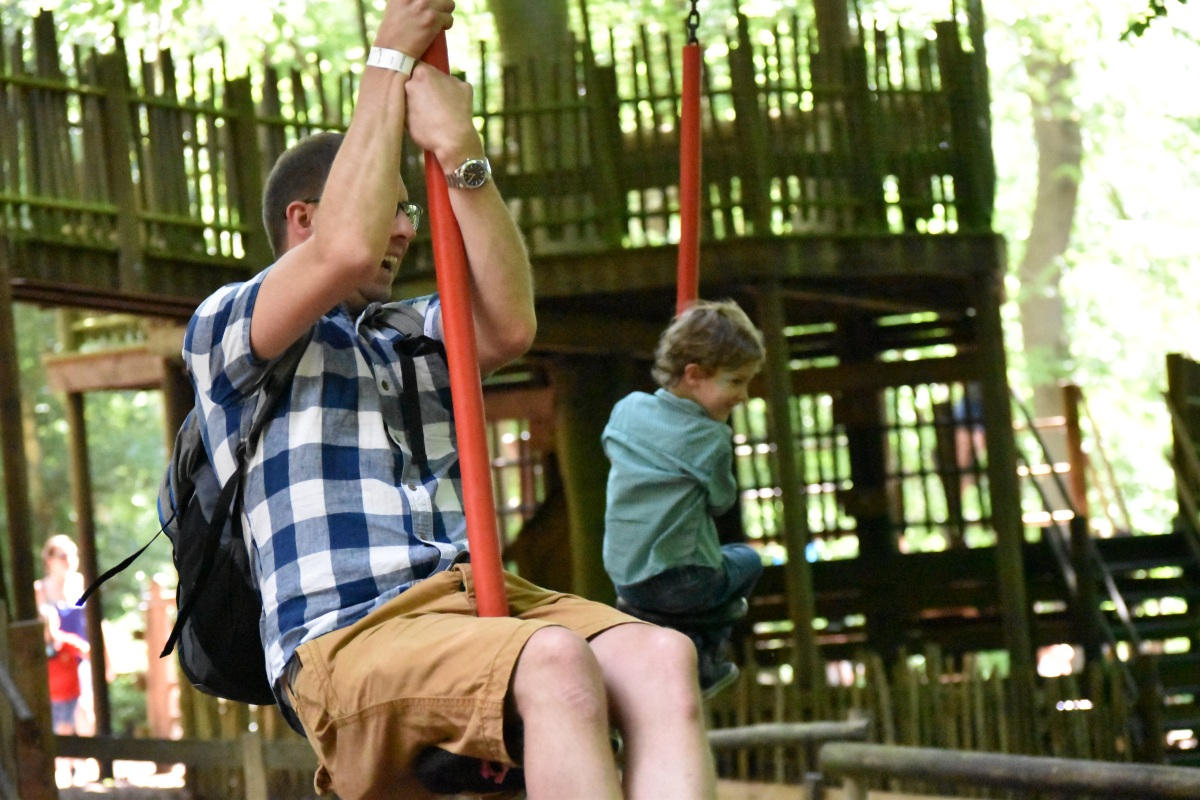 A photograph of Rob on the zip wire. It's not just for the kids!