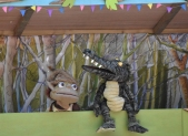 A photograph of Swampy and Mildred on the storytelling stage.