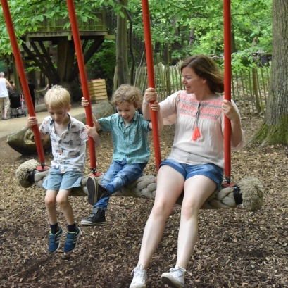 A photograph of Ollie, Ben and Emma on the three-person swing.