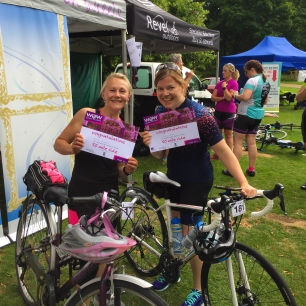 A photograph of Emma with another Emma, her riding buddy. They're both holding their certificates.