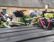 A photograph of Emma and Rob's bikes leaning against a pub garden table. They had a pit stop on a Fenland cycle ride.