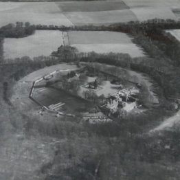 A black and white photograph showing the circular Wandlebury hillfort enclosure.
