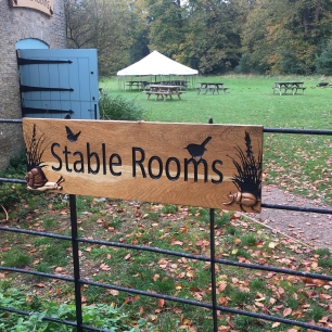 A photograph of a sign for the stable rooms.