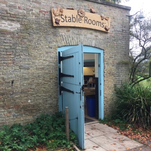 A photograph of the blue entrance door to the education centre at Wandlebury; formerly the stable rooms.
