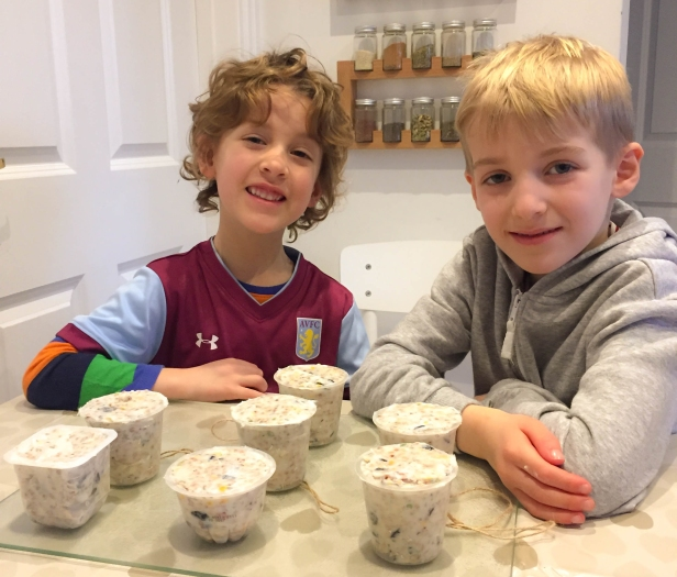 A photograph of Ben and Ollie with the filled pots ready for chilling in the fridge.
