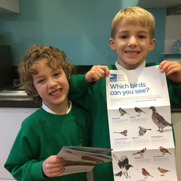 A photograph of Ben and Ollie with the Big Garden Birdwatch pack they ordered from the RSPB.