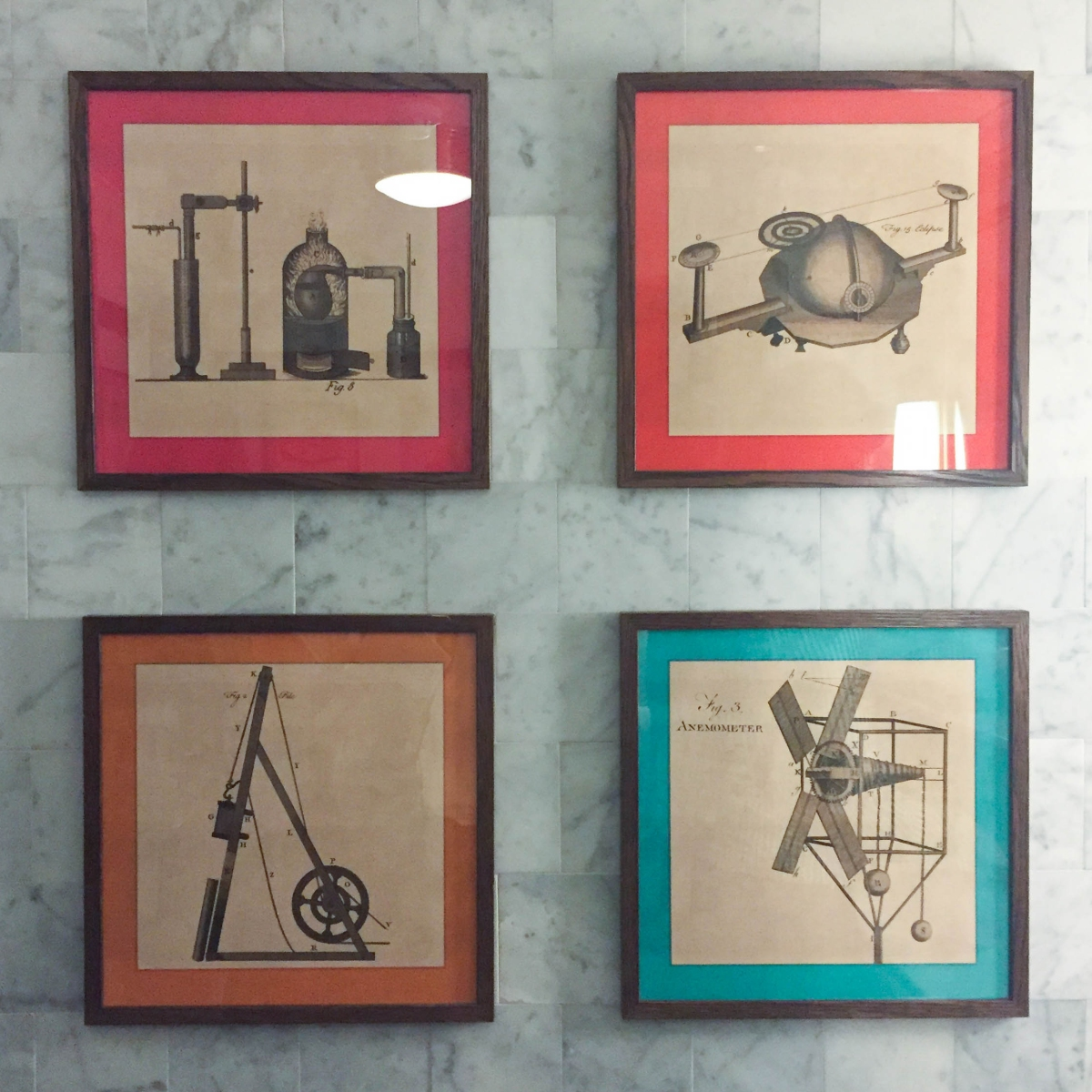 A photograph of four drawings of scientific instruments