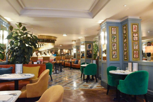 A photograph of the main dining area with colour features everywhere