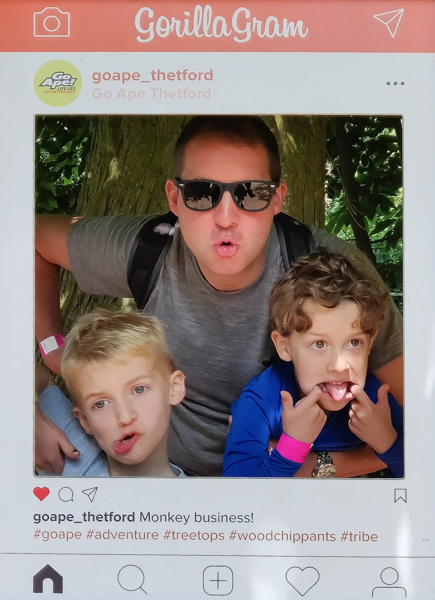 A photograph of Ollie, Rob and Ben making funny faces in the Gorilla Gram photo frame.