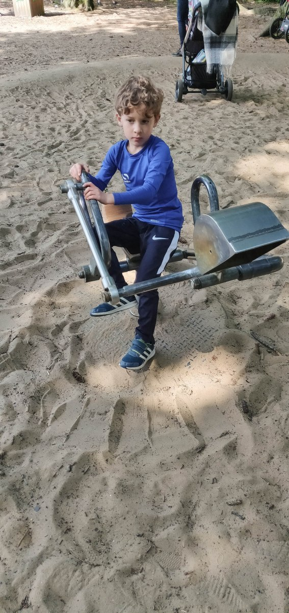 A photograph of Ben with the mini sand digger.