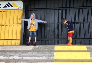 A photo of Ollie and Ben standing at the back of the Habbin, neither looking at the camera