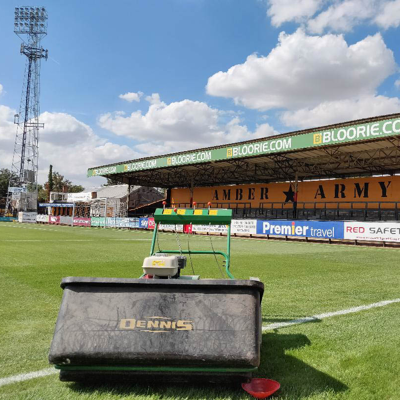 A photo of the pitch on the eve of the new season with a lawnmower in the foreground