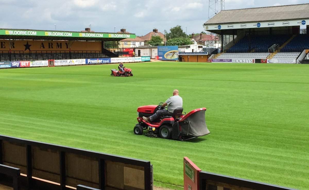 A photo of Ian Darler and Mick Brown on their mowers