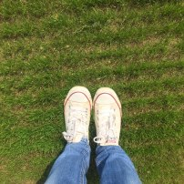 A photo of Emma's feet on the pitch after a couple of week's growth