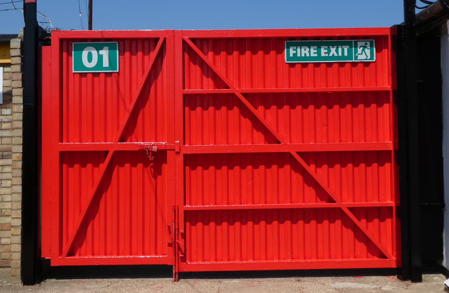 A photo of a fire exit with a fresh coat of red paint