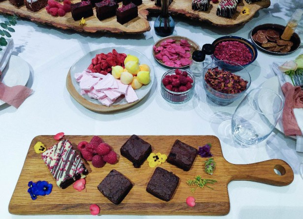 A photograph of Emma's platter with four plain brownies to decorate. The decorating options are in bowls.