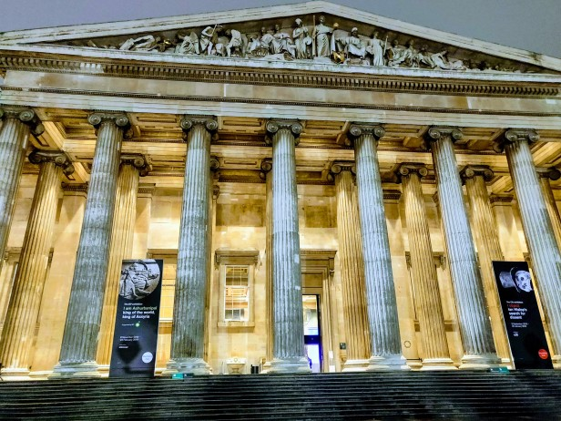 The columned frontage of the British Museum lit at night