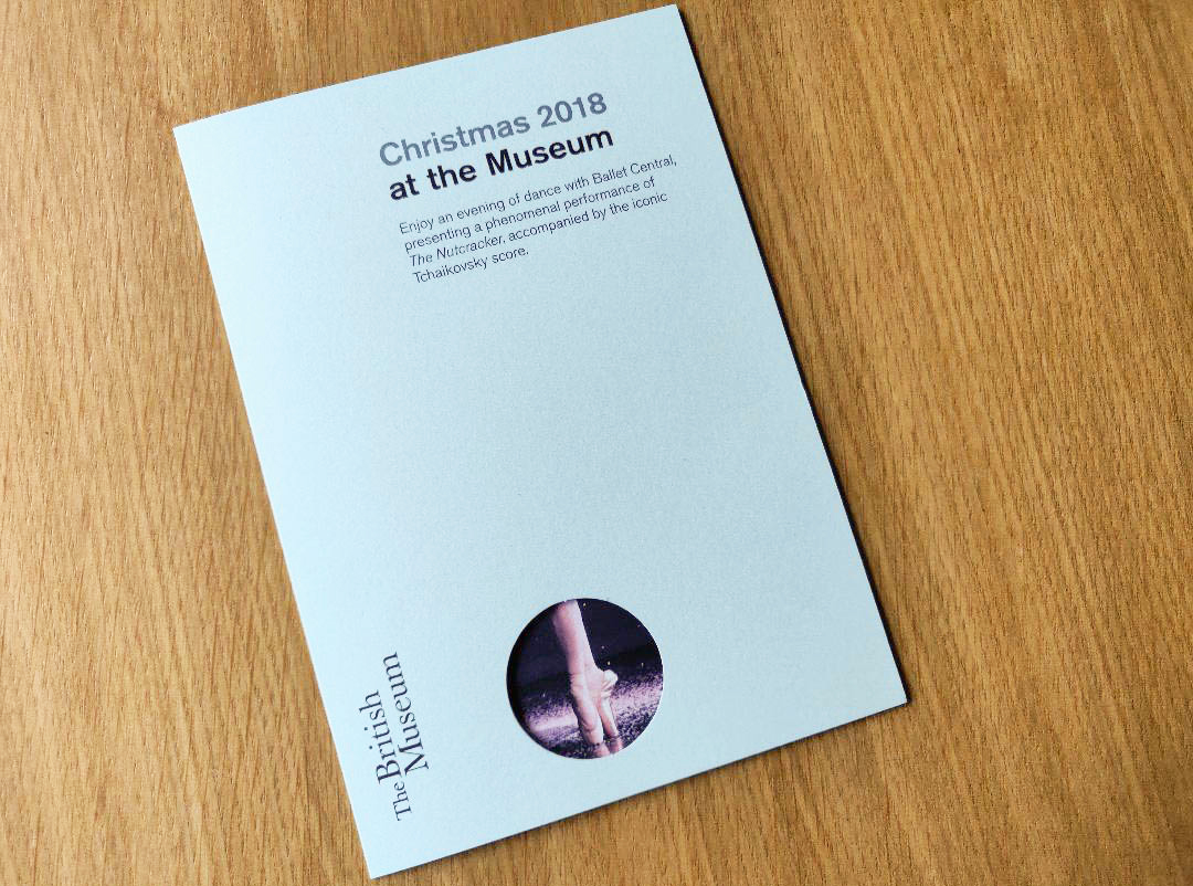 A photograph of The Nutcracker Museum programme on top of a wooden table