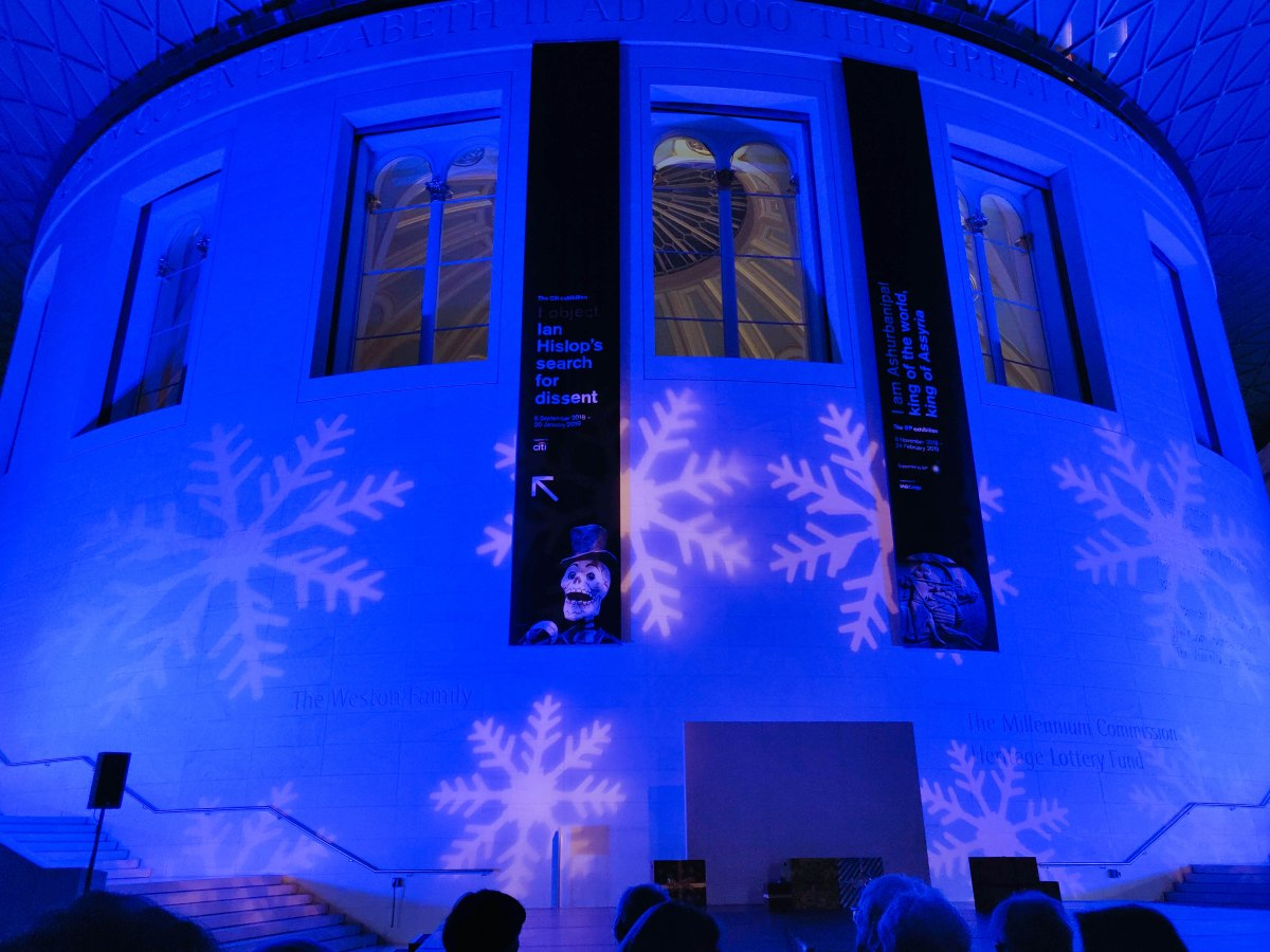 The outer walls of the Reading Room are glowing purple with projected giant white snowflakes