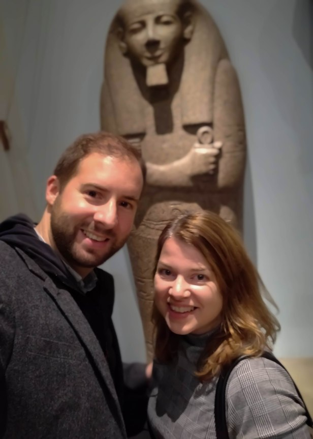 A selfie of Rob, Emma and a sarcophagus lid of Pahemnetjer, High Priest of Ptah